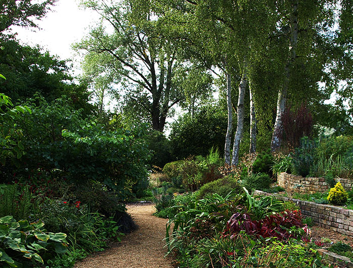 Path below the terraces at Fullers Mill Garden